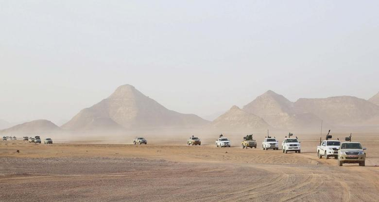 Troops and vehicles from the national army in Kufra, are seen taking part in a ''Operation Dignity'' mission, at the Libyan-Egyptian border, near Kufra, June 4, 2014.  REUTERS/Stringer
