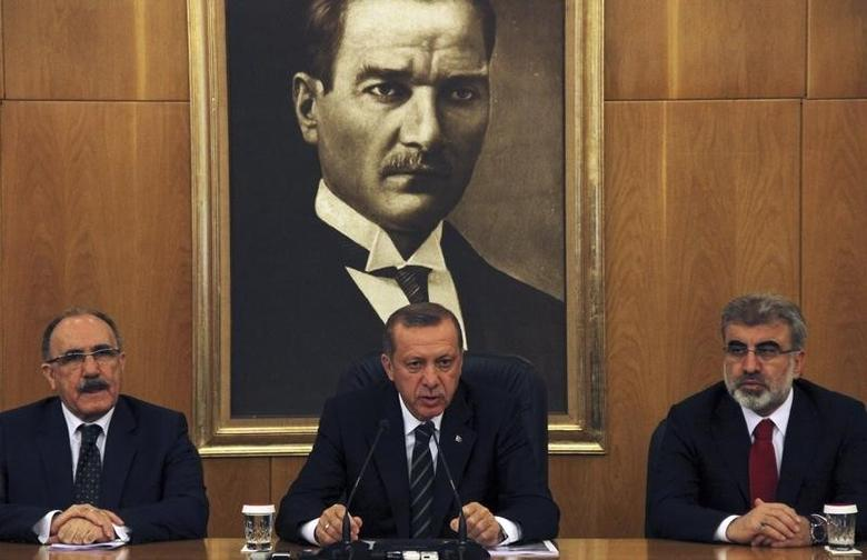 Turkey's Prime Minister Tayyip Erdogan, flanked by his deputy Besir Atalay (L) and Energy Minister Taner Yildiz (R), speaks during a news conference at Ataturk International airport in Istanbul April 4, 2014. REUTERS/Stringer