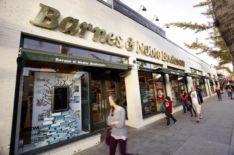 People walk by a Barnes & Noble bookstore in Pasadena, California November 26, 2013. REUTERS/Mario Anzuoni/Files