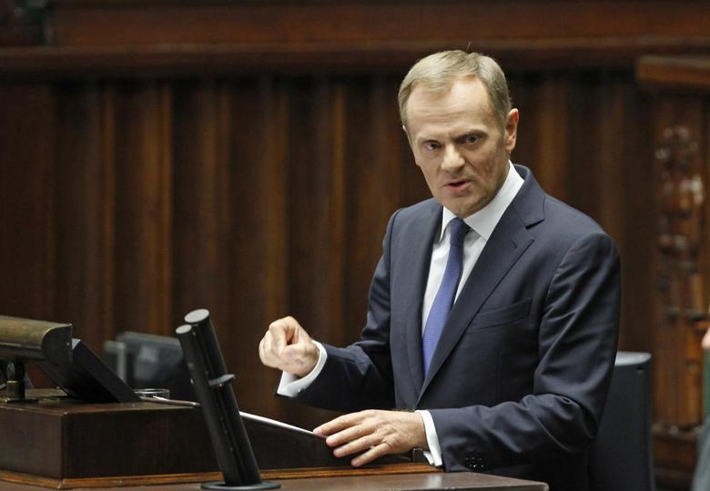 Poland's Prime Minister Donald Tusk gestures as he speaks in Parliament in Warsaw June 25, 2014. REUTERS/Jerzy Dudek