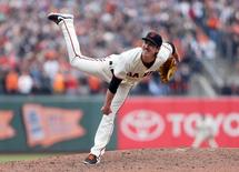 San Francisco Giants starting pitcher Tim Lincecum (55) follows through on a pitch during the ninth inning against the San Diego Padres at AT&T Park. The San Francisco Giants defeated the San Diego Padres 4-0. Mandatory Credit: Kelley L Cox-USA TODAY Sports