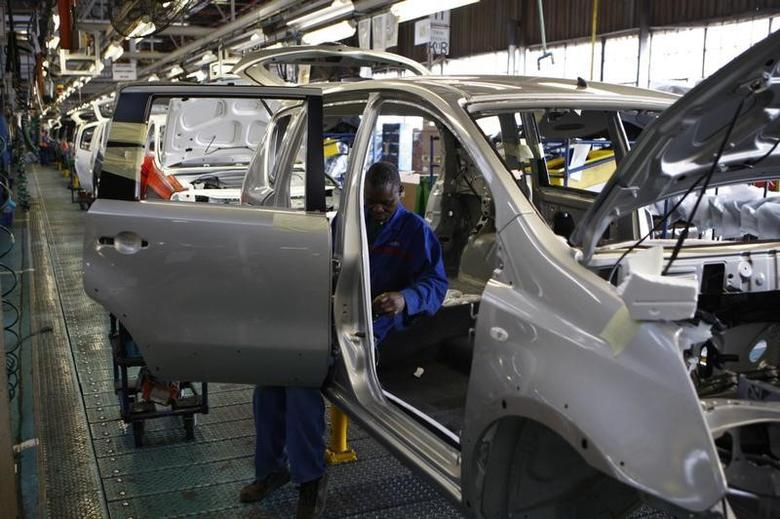 A worker assembles a car at a Nissan's manufacturing plant in Rosslyn, outside Pretoria, September 11, 2009. REUTERS/Siphiwe Sibeko