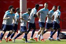 Jogadores da seleção de Portugal durante treinamento antes da partida contra Gana pelo Grupo G da Copa do Mundo,  em Brasília. 25/06/2014.  REUTERS/Ueslei Marcelino