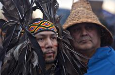 Native protesters listen to speeches during an Idle No More march at the Peace Arch border crossing between Canada and the U.S. in Surrey, British Columbia January 5, 2013. REUTERS/Andy Clark