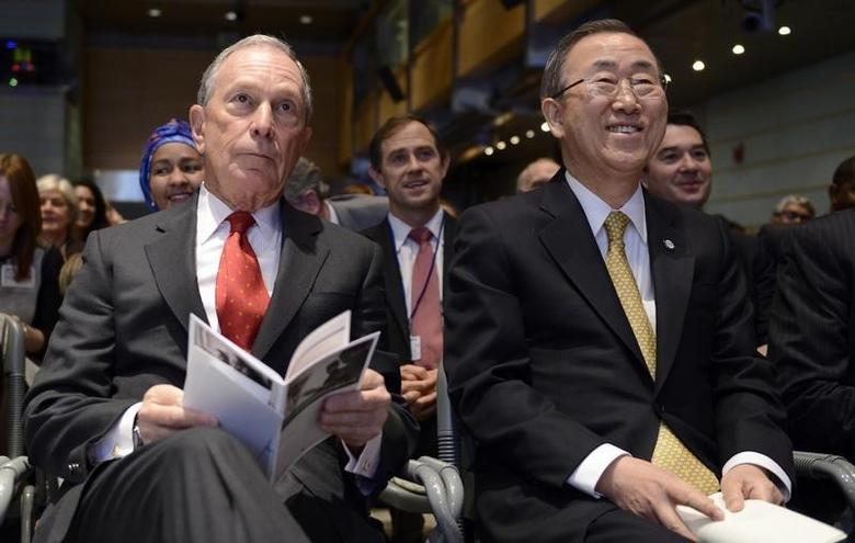 Former New York City Mayor Michael Bloomberg (L) and UN Secretary-General Ban Ki-moon listen to opening remarks at a ''Toward Universal Health Coverage for 2030'' seminar during the IMF/World Bank 2014 Spring Meetings in Washington April 11, 2014.REUTERS/Mike Theiler