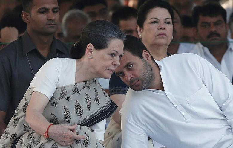 Congress party chief Sonia Gandhi (L) listens to her son and lawmaker Rahul Gandhi (R), at her husband and former Prime Minister Rajiv Gandhi's memorial, on the occasion of his 23rd death anniversary, in New Delhi May 21, 2014. REUTERS/Adnan Abidi/Files