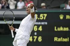 Rafael Nadal of Spain reacts after defeating Lukas Rosol of the Czech Republic in their men's singles tennis match at the Wimbledon Tennis Championships, in London June 26, 2014. REUTERS/Max Rossi