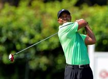 Tiger Woods hits his tee shot on the 18th hole during the first round of the Quicken Loans National golf tournament at Congressional Country Club - Blue Course. Tommy Gilligan-USA TODAY Sports