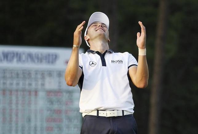 Martin Kaymer of Germany celebrates on the 18th green after winning the U.S. Open Championship golf tournament in Pinehurst, North Carolina, June 15, 2014.  REUTERS/Robert Galbraith