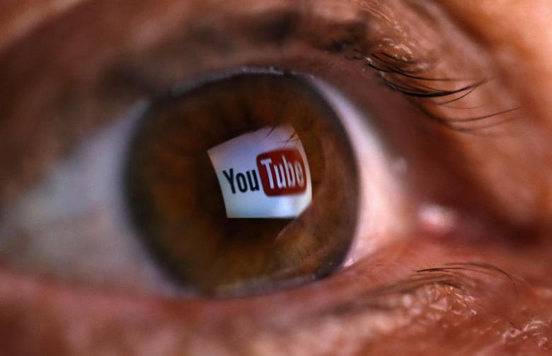 A picture illustration shows a YouTube logo reflected in a person's eye, in central Bosnian town of Zenica, early June 18, 2014. REUTERS/Dado Ruvic/Files