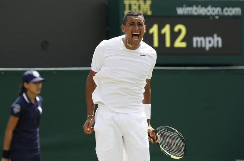 Nick Kyrgios of Australia reacts during his men's singles tennis match against Richard Gasquet of France at the Wimbledon Tennis Championships, in London June 26, 2014.  REUTERS/Suzanne Plunkett