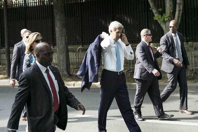U.S. Secretary of State John Kerry (C) walks to the U.S. Embassy in Paris June 26, 2014.  REUTERS/Brendan Smialowski/Pool