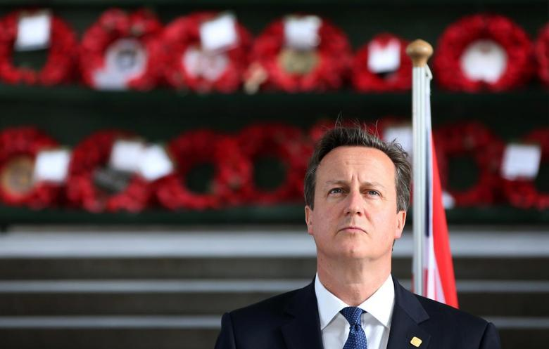 Britain's Prime Minister David Cameron looks on as he attends a ''Last Post'' ceremony at the Menin Gate in Ypres, June 26, 2014, to commemorate the centenary of the start of World War I.     REUTERS/Francois Lenoir