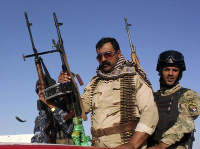 Iraq's top Shi'ite cleric calls for prime minister to...
