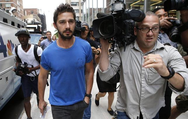 Actor Shia LaBeouf, who starred in the ''Transformers'' movies and the play ''Nymphomaniac,'' leaves a Midtown Manhattan court in New York City June 27, 2014, after he was arrested inside New York's Studio 54 during a performance of ''Cabaret,'' police said. The actor was charged with criminal conduct and disorderly conduct and taken into custody.  REUTERS/Mike Sega