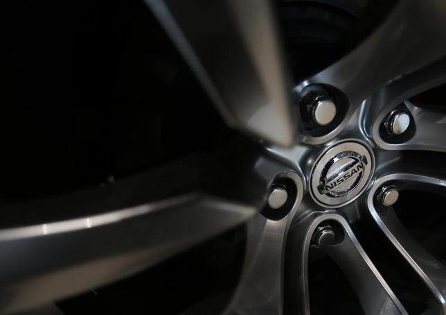 A logo of Nissan Motor Co is seen on the wheel of a car at the company's showroom in Yokohama, south of Tokyo November 1, 2013. REUTERS/Yuya Shino/Files