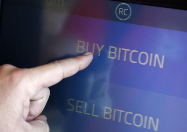 The screen of Southern California's first two bitcoin-to-cash ATMs which began operating today, is seen in Locali Conscious Convenience store in Venice, Los Angeles, California, June 21, 2014. REUTERS/Lucy Nicholson