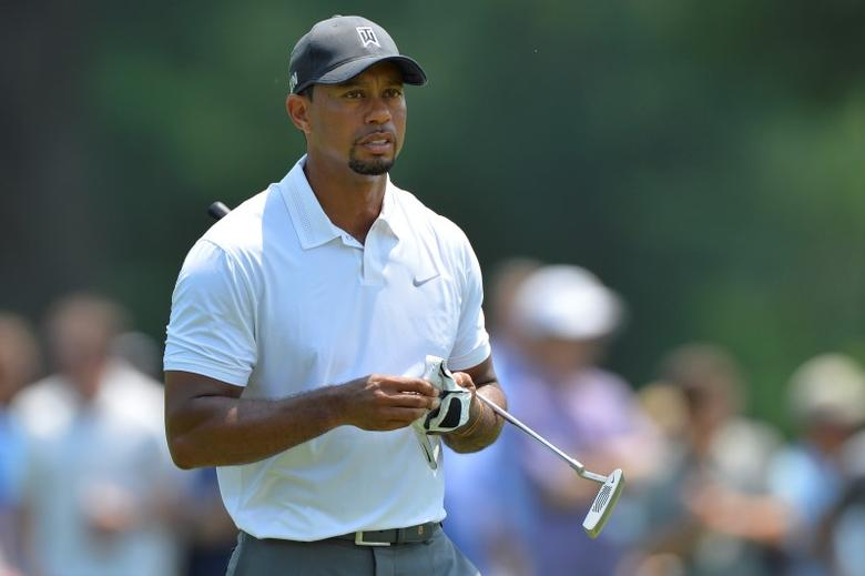 Tiger Woods walk to the fourth green during the second round of the Quicken Loans National golf tournament at Congressional Country Club - Blue Course. Tommy Gilligan-USA TODAY Sports