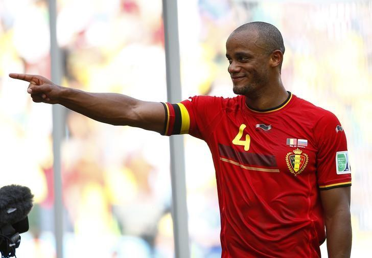 Belgium's Vincent Kompany gestures after winning their 2014 World Cup Group H soccer match against Russia at the Maracana stadium in Rio de Janeiro June 22, 2014. REUTERS/Tony Gentile
