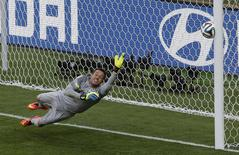 Brazil's goalkeeper Julio Cesar dives as the decisive penalty shot by Chile's Gonzalo Jara hits the goalpost in the penalty shootout during their 2014 World Cup round of 16 game at the Mineirao stadium in Belo Horizonte   REUTERS/Leonhard Foeger