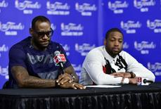Jun 15, 2014; San Antonio, TX, USA; Miami Heat forward LeBron James (6) and guard Dwyane Wade (3) speak during a press conference after game five of the 2014 NBA Finals at AT&T Center. Mandatory Credit: Bob Donnan-USA TODAY Sports - RTR3TZ0J