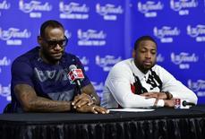 Jun 15, 2014; San Antonio, TX, USA; Miami Heat forward LeBron James (6) and guard Dwyane Wade (3) speak during a press conference after game five of the 2014 NBA Finals at AT&T Center. Mandatory Credit: Bob Donnan-USA TODAY Sports - RTR3TZ0J