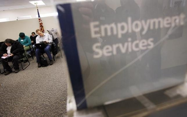 People fill out paperwork before attending an orientation class at the Manhattan branch of the New York State Department of Labor March 4, 2009 file photo.     REUTERS/Shannon Stapleton