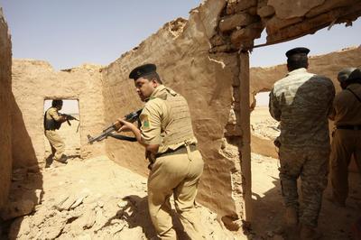 Iraqi army presses Tikrit assault as lawmakers scrambl...