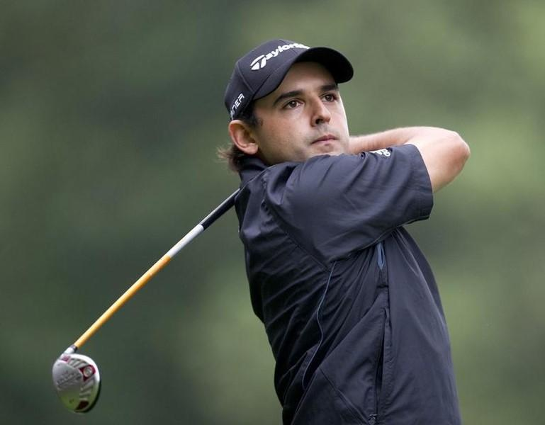 Paraguay's Fabrizio Zanotti plays a shot on the fourth hole on the final day of the KLM Open Golf Tournament in Hilversum September 12, 2010. REUTERS/Paul Vreeker/United Photos