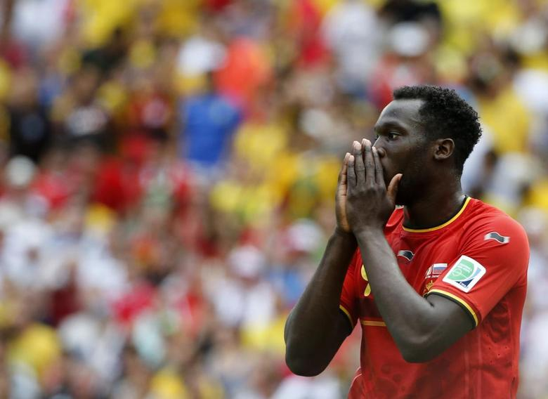 Belgium's Romelu Lukaku reacts after missing to a chance to score during their 2014 World Cup Group H soccer match against Russia at the Maracana stadium in Rio de Janeiro June 22, 2014. REUTERS/Alessandro Garofalo