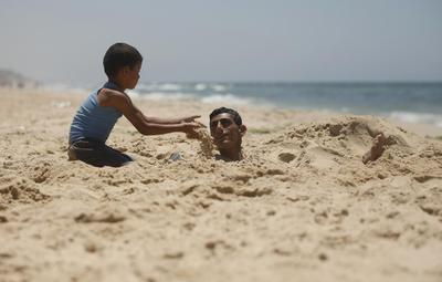 Sewage at the beaches, piles of garbage mar Gaza's...