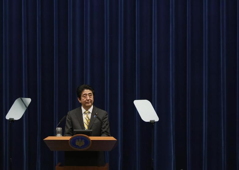 Japan's Prime Minister Shinzo Abe speaks next to teleprompters during a news conference at his official residence in Tokyo June 24, 2014. REUTERS/Yuya Shino