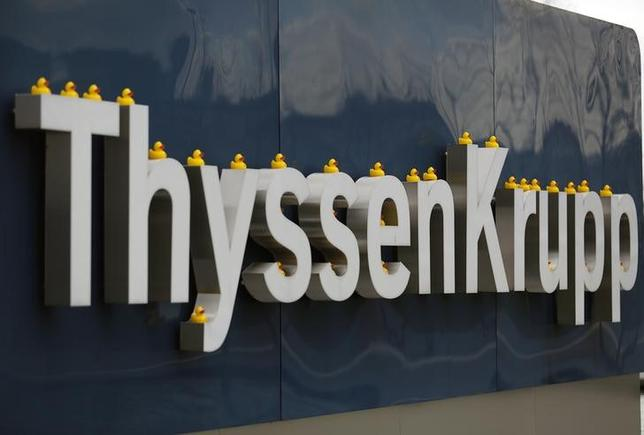 Toy ducks are placed on a sign of Germany's top steelmaker ThyssenKrupp during a protest at their headquarters in Essen February 25, 2014. REUTERS/Ina Fassbender