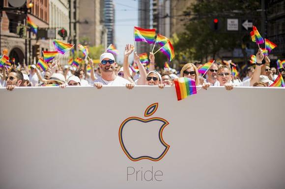 Apple employees carry rainbow flags as they march in the San Francisco Gay Pride Festival in California June 29, 2014. REUTERS/Noah Berger