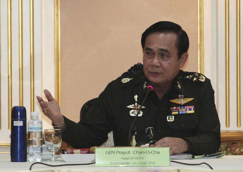 Thai Army chief General Prayuth Chan-ocha speaks during a meeting with members of the International Chamber of Commerce at the Royal Thai Army Headquarters in Bangkok June 19, 2014. REUTERS/Chanat Katanyu/Pool