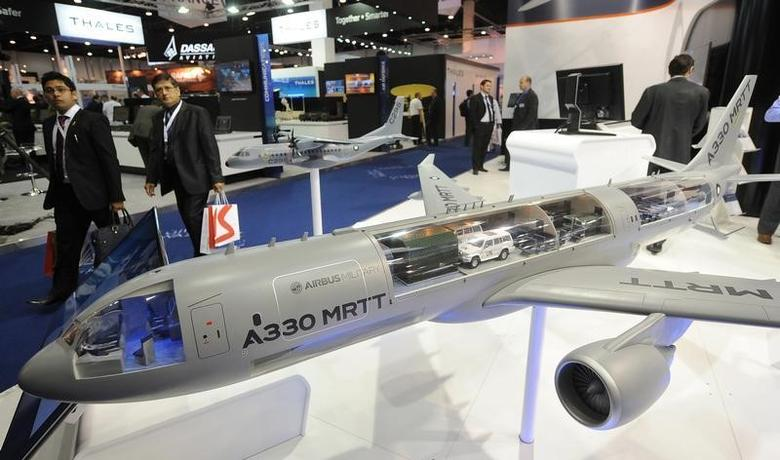 Visitors walk past a miniature model of the Airbus A330 Multi Role Tanker Transport (MRTT) during the International Defence Exhibition and Conference (IDEX) at the Abu Dhabi National Exhibition Centre February 19, 2013. REUTERS/Ben Job
