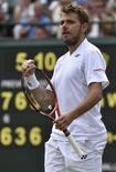 Stanislas Wawrinka of Switzerland celebrates after winning his men's singles tennis match against Lu Yen-Hsun of Taiwan on No.1 court at the Wimbledon Tennis Championships in London June 26, 2014.  REUTERS/Toby Melville
