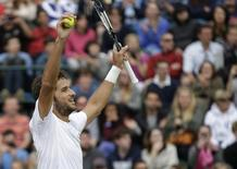 Feliciano Lopez of Spain reacts after defeating John Isner of the U.S. in their men's singles tennis match at the Wimbledon Tennis Championships, in London June 30, 2014. REUTERS/Max Rossi