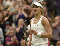 Eugenie Bouchard of Canada reacts after defeating Alize Cornet of France in their women's singles tennis match at the Wimbledon Tennis Championships, in London June 30, 2014.REUTERS/Toby Melville