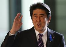 Japan's Prime Minister Shinzo Abe waves upon his arrival at his official residence in Tokyo July 1, 2014.  REUTERS/Issei Kato