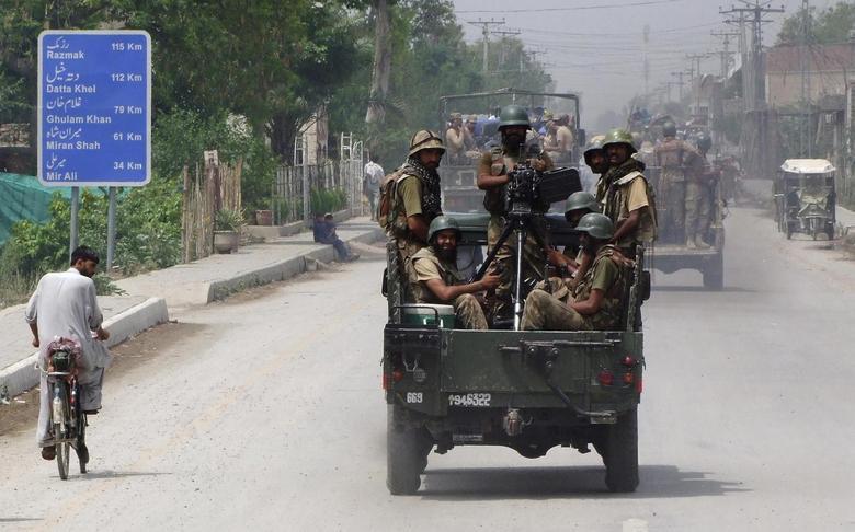 Soldiers drive toward North Waziristan, from Bannu, June 20, 2014. REUTERS/Ihsan Khattak