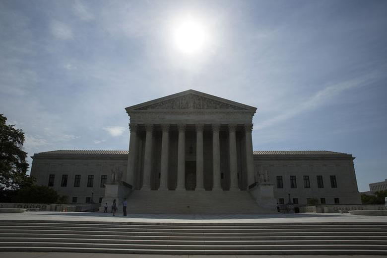 The sun rises over the Supreme Court in Washington June 19, 2014. The U.S. Supreme Court on Thursday ruled that implementing an abstract idea using a computer does not make an invention patent eligible.     REUTERS/Joshua Roberts