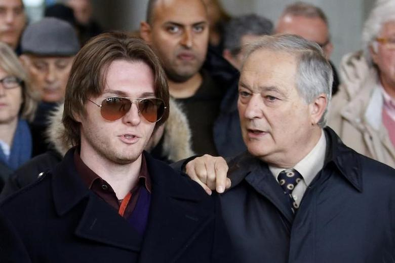 Raffaele Sollecito (L), convicted of killing British student Meredith Kercher in Italy on November 2007, talks with his father Francesco as they leave after attending a retrial session in Florence January 30, 2014. REUTERS/Giampiero Sposito
