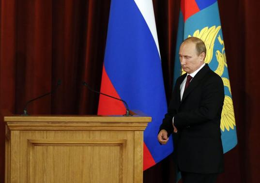 Russian President Vladimir Putin approaches a rostrum to deliver a speech during a meeting with Russian ambassadors, envoys and diplomats at the Foreign Ministry headquarters in Moscow, July 1, 2014.  REUTERS/Maxim Zmeyev