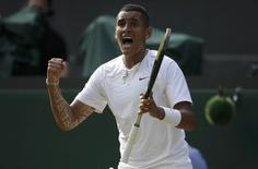 Nick Kyrgios of Australia reacts during his men's singles tennis match against Rafael Nadal of Spain at the Wimbledon Tennis Championships, in London July 1, 2014.           REUTERS/Max Rossi