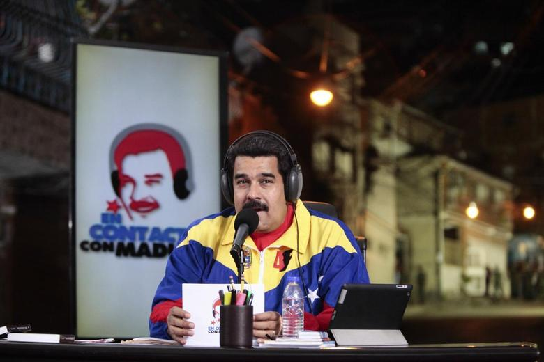 Venezuela's President Nicolas Maduro speaks during his radio program ''In contact with Maduro'' at Catia neighbourhood in Caracas, in this handout photo provided by Miraflores Palace July 1, 2014. REUTERS/Miraflores Palace/Handout via Reuters
