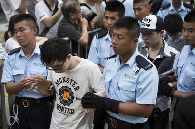 Hong Kong protesters lifted kicking and screaming from...