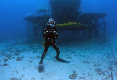 Cousteau's grandson surfaces after record underwater...