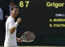 Grigor Dimitrov of Bulgaria reacts after defeating Andy Murray of Britain in their men's singles quarter-final tennis match at the Wimbledon Tennis Championships, in London July 2, 2014. REUTERS/Suzanne Plunkett