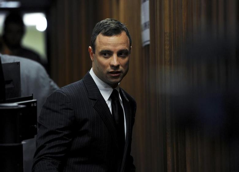 South African Olympic and Paralympic sprinter Oscar Pistorius arrives in court for his trial in Pretoria July 2, 2014. REUTERS/Werner Beukes/Pool
